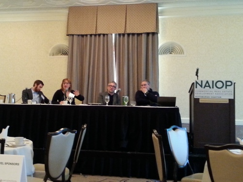 (From left) Dan Gilman, Kyra Straussman, Mark Minnerly and Todd Reidbord tell the East Liberty turnaround story at NAIOP Pittsburgh.